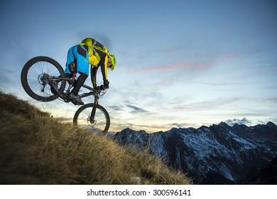 Biker in evening mood in the highest action