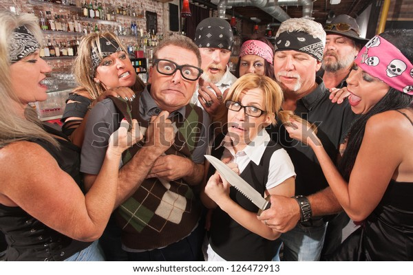 Biker gang mugging scared nerd couple in bar