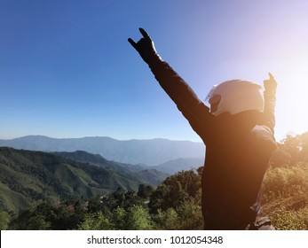 Biker hands up with mountain view landscape. Traveller by motorcycle concept. Biker happy in freedom lifestyle travel by motorbike.