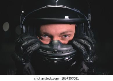 Biker in the helmet close up portrait.