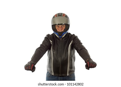 Biker with the helmet looking sharp in driving pose