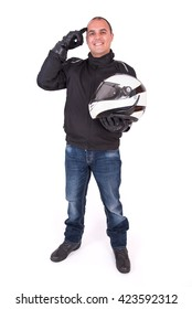 Biker holding his helmet and pointing his head on white background
