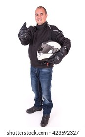 Biker holding his helmet under his arm and with thumbs up on white background