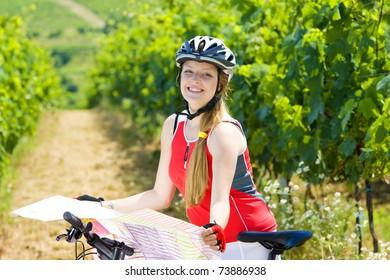 biker holding a map in vineyard, Czech Republic