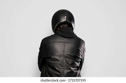 Biker man over isolated grey background