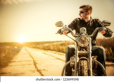 Biker man sits on a bike
