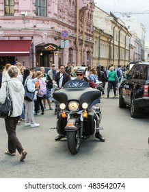 Biker on a black motorcycle. St. Petersburg, Russia - 12 August, 2016. The annual International Festival of Motor Harley Davidson in St. Petersburg Ostrovsky Square.
