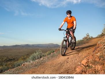 Biker on Desert Trail
