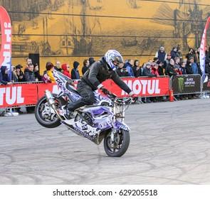 Biker on the front wheel. St. Petersburg Russia - 15 April, 2017. International Motor Show IMIS-2017 in Expoforurum. Sports motorcycle show of bikers on the open area.