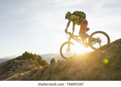 biker on the hill enjoy the sunset