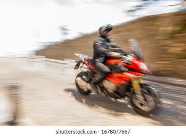 Biker on a motobike. Blurred effect. Speed.