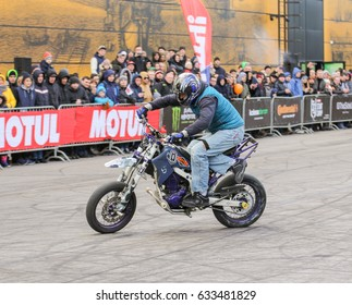 Biker on motobike. St. Petersburg Russia - 15 April, 2017. International Motor Show IMIS-2017 in Expoforurum. Sports motorcycle show of bikers on the open area.