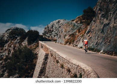 Biker on the road bicycle ride uphill on the famous Sa Calobra climb in Spain.