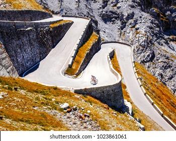 Biker on the road - Cyclist photo. Tour, Italy, Passo dello Stelvio