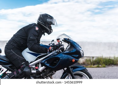biker rides motorcycle, motorcyclist side view, close up of bike rides motorcycle, motorcyclist side view, close-up, motorcycle racing, motorcycle profile and racer