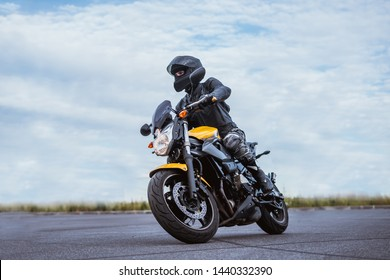 biker rides motorcycle, turns, bright colors motorcycle, sports fast motorcycle