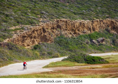 Biker riding bicycle in the Mountains of Cyprus