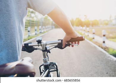 Biker riding bike on the summer road,sport adventure concept