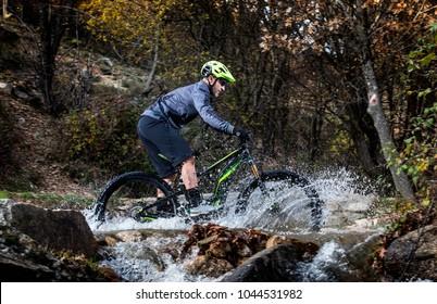 biker riding an Ebike over a river