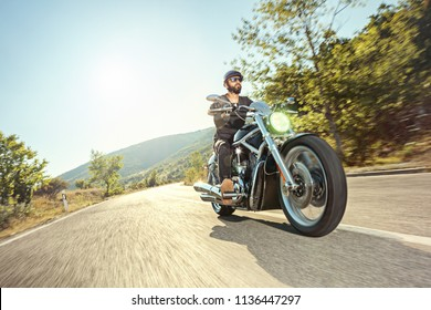 Biker riding a motorcycle on open road