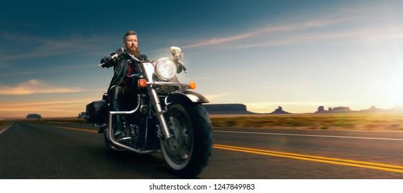 Biker riding on classical chopper, sunset