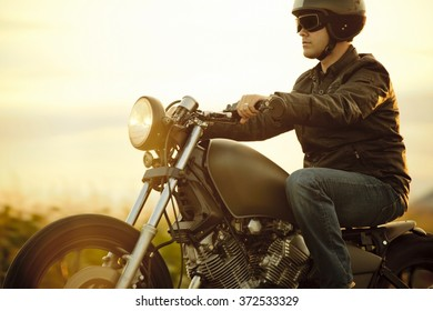 Biker riding in the sunset