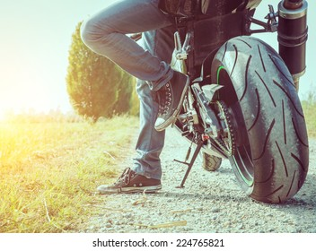 biker taking a break in the countryside. concept about motorbikes
