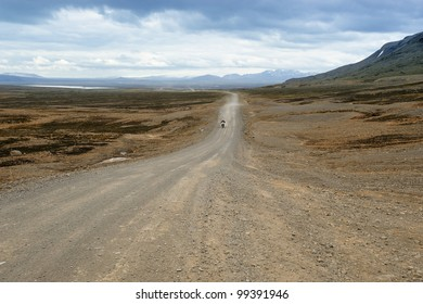 a biker traveling on a dirt road of Iceland