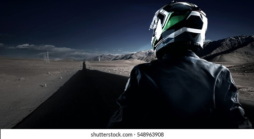 Biker were helmet  look forward road to mountain.
