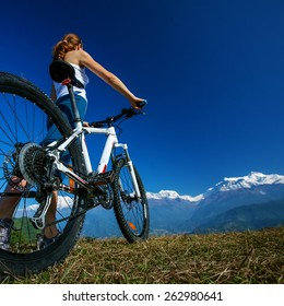 Biker-girl in Himalaya mountains, Annapurna region