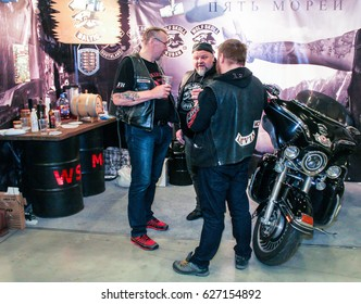 Bikers with beer at the exhibition. St. Petersburg Russia - 15 April, 2017. International Motor Show IMIS-2017 in Expoforurum. Visitors and participants of the annual moto-salon in St. Petersburg.