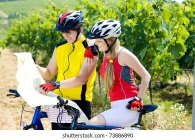 bikers holding a map in vineyard, Czech Republic