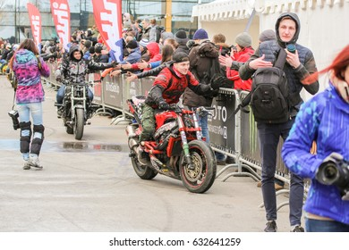 Bikers are passing along the spectators. St. Petersburg Russia - 15 April, 2017. International Motor Show IMIS-2017 in Expoforurum. Sports motorcycle show of bikers on the open area.