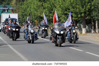 Bikers. Russia, August 2013: Motorcyclists with flags traveling in the Tyumen region. City of Zavodoukovsk.