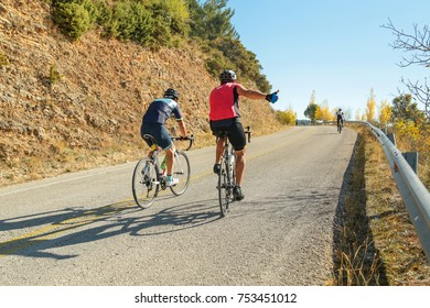 bikers uphill just before the end hand like