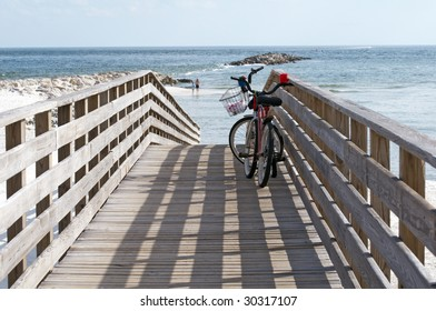 Bikes on a boardwalk leading to the beach on the Alabama/Florida gulf coast.