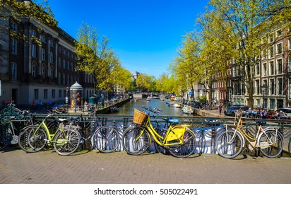 Bikes on the bridge in  Amsterdam, Netherlands. Canals of Amsterdam, Netherland