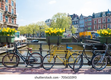 Bikes on the bridge in Amsterdam Netherlands.