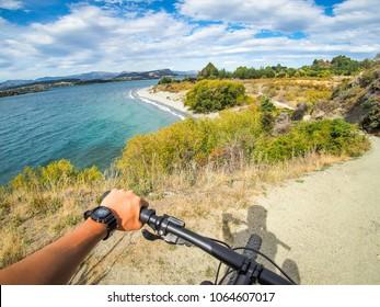 Biking along Lake Wanaka in New Zealand.