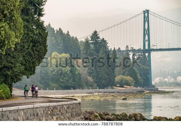 Biking along Stanley Park in Vancouver, Canada.