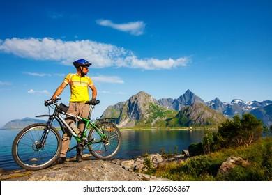 Biking in Norway against picturesque landscape. Bike, active.