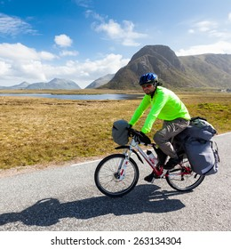 Biking in Norway against picturesque landscape