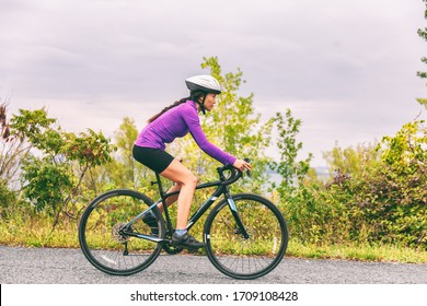 Biking road bike athlete cyclist woman riding bicycle training cardio outdoor. Active fit lifestyle fitness exercise workout.