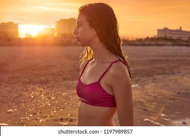 Bikini girl in the beach sand at summer Mediterranean