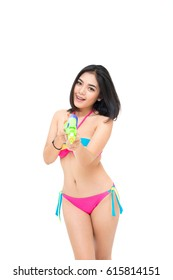 Bikini girl holding a water gun and happy playing. On Songkran Festival Day, isolated on white studio background.