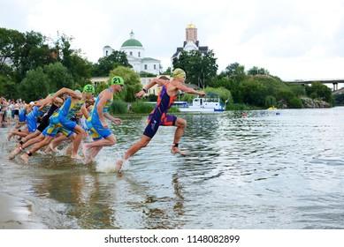 BILA TSERKVA, UKRAINE - JULY 15: The triathletes compete in swimming component  during International triathlon competition - the Cup of Bila Tserkva city and Cup of Ukraine on July 15, 2018 in Bila Ts