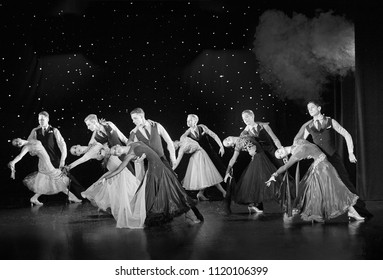 "Bila Tserkva, Ukraine. June 18, 2018 ballroom dance sport club ""Golden club"" concert 5th anniversary of the collective. Couples Dancer in ballroom showing Viennese waltz. Black and white photography"