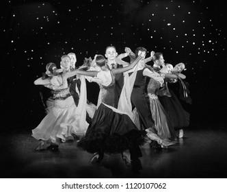 "Bila Tserkva, Ukraine. June 18, 2018 ballroom dance sport club ""Golden club"" concert dedicated anniversary of the collective. Young couples in ballroom dancing Viennese waltz. Black and white photogra"