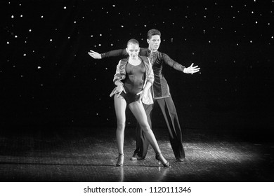 "Bila Tserkva, Ukraine. June 18, 2018 ballroom dance sport club ""Golden club"" concert dedicated to the anniversary of the collective. Couple dancers in ballroom dancing latin. Black and white photograp"