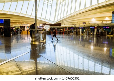 Bilbao, Biscay, Basque Country, Spain - February, 15th, 2019 :  A child runs inside the Bilbao Airport main terminal opened in 2000 and designed by architect  Santiago Calatrava.